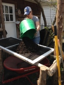 preparing to sift compost